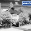 "Oasis Used A Photo Of John Lennon's Childhood Home For ""Live Forever"" Single"