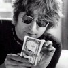 "Photo Find: John Lennon ""Making It Rain"""