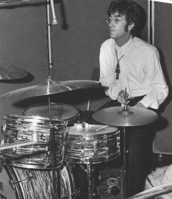 John Lennon The Beatles Playing Drums