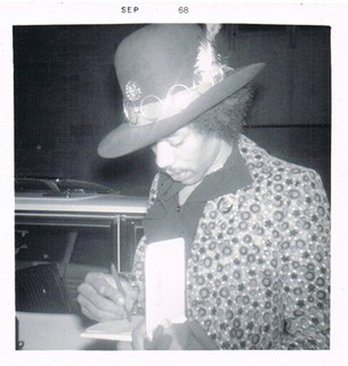 Jimi Hendrix Signing Autographs For Fans