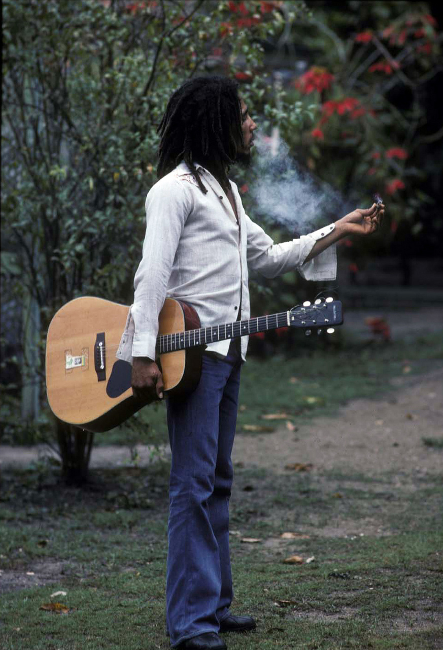 Bob Marley Smoking A Joint In His Backyard